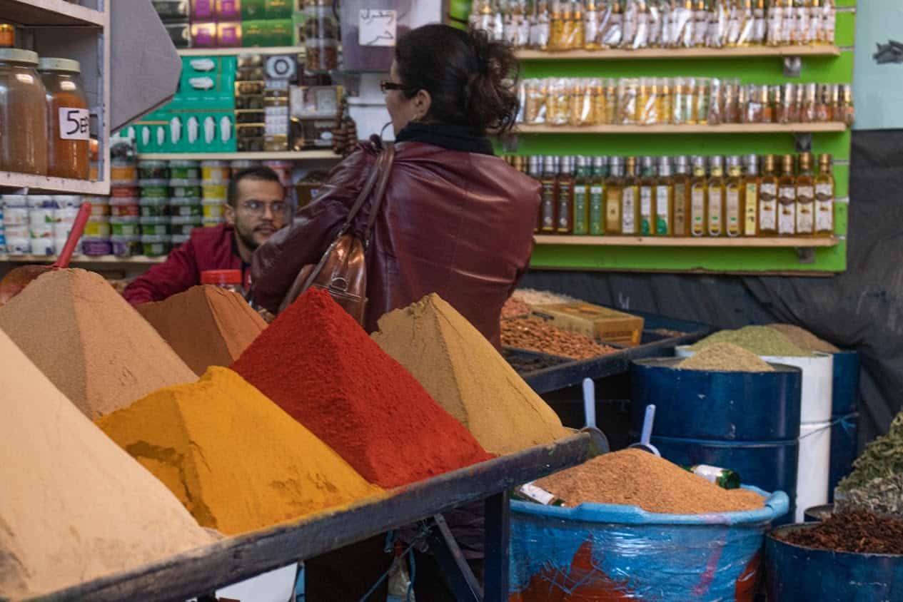 Mounds of spices and bottles of oil for sale. Photo credit: Alexis Broadnax.