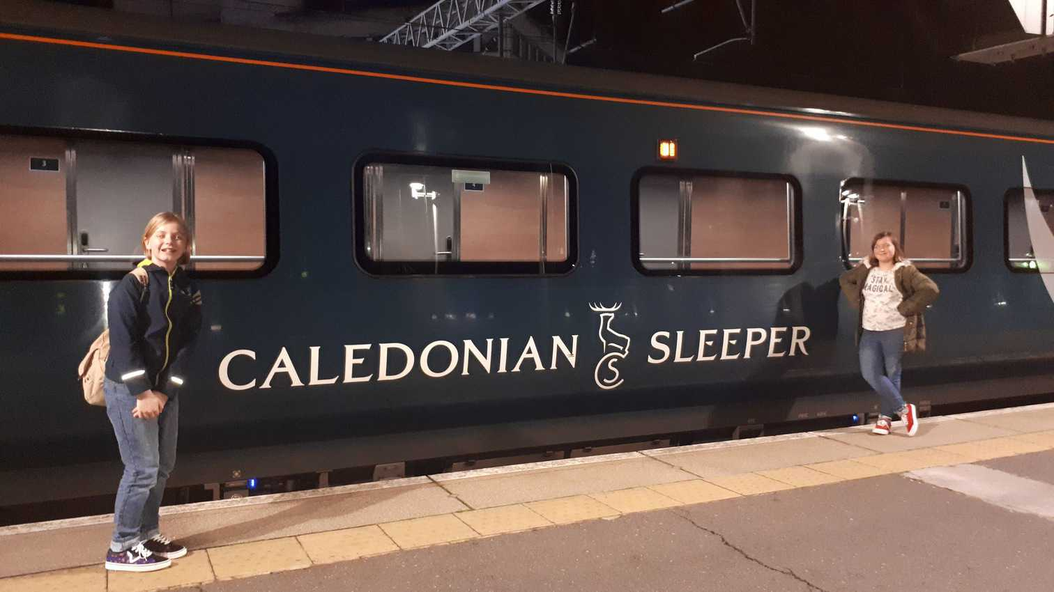 Outside one of the navy blue Caledonia Sleeper cars in the station.