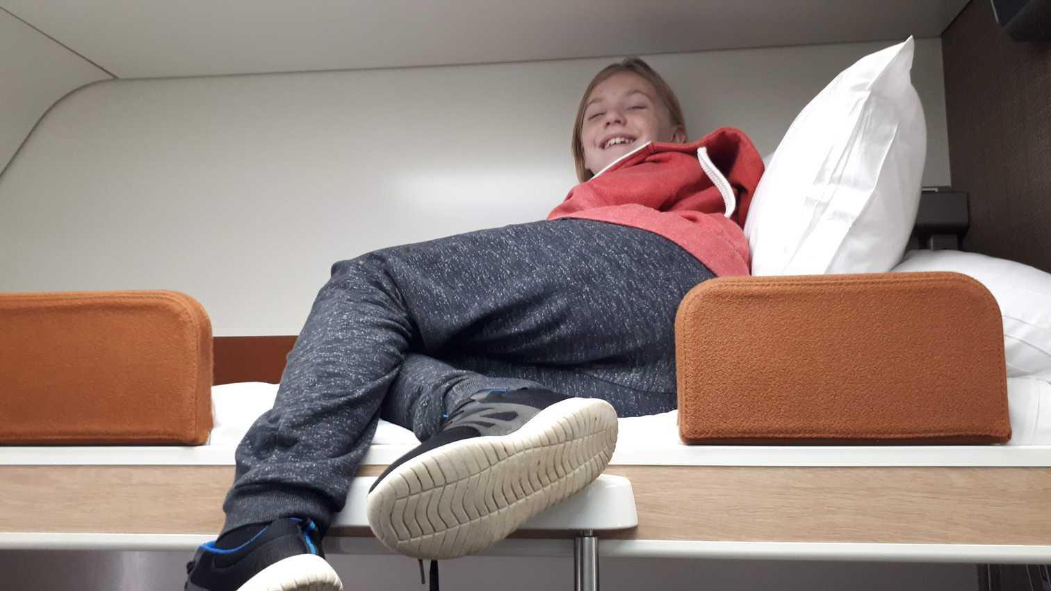 Ruaridh tries out the top bunk.