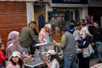 Street vendors preparing snail soup for a Moroccan family in the medina.