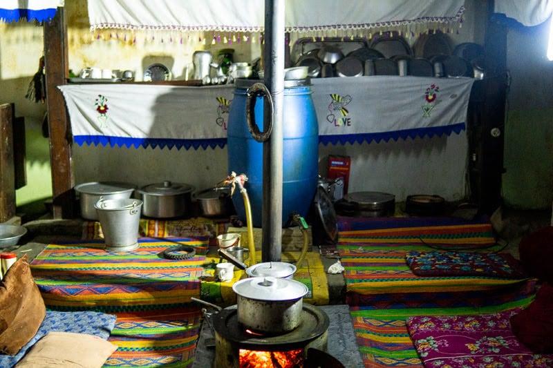 Salt tea boils inside of a local home in Phander Village