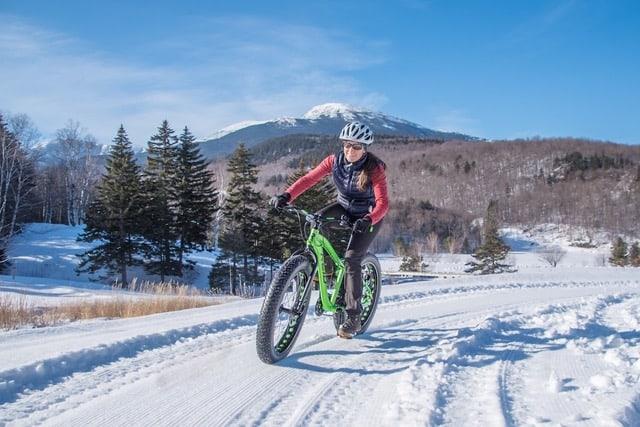 Fat tire biker near Attitash Ski Resort in New Hampshire's White Mountains. Wiseguy Creative photo.