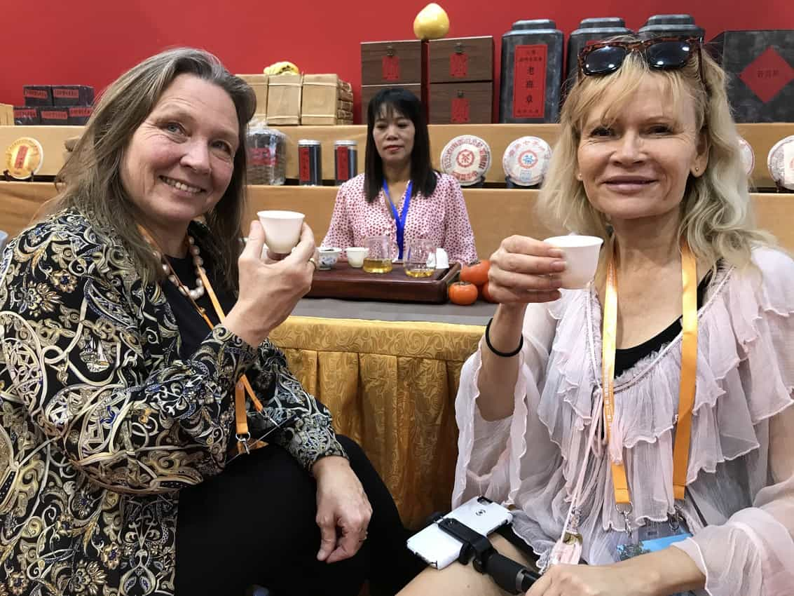 Friends Sanna and Gitte enjoy Chinese tea inside the Expo.