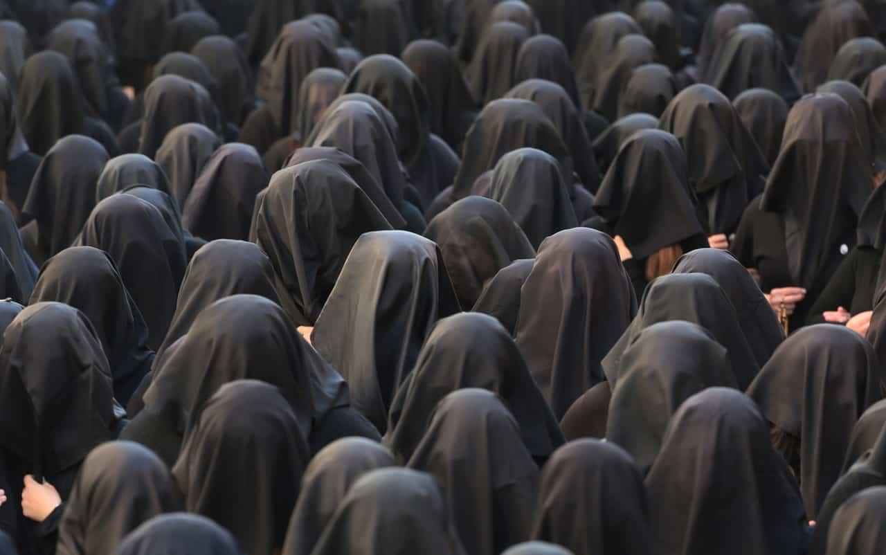 Women dressed all in black commemorate Mary's suffering during the Processione della Desolata in Canosa. Photo courtesy of VAWAA.