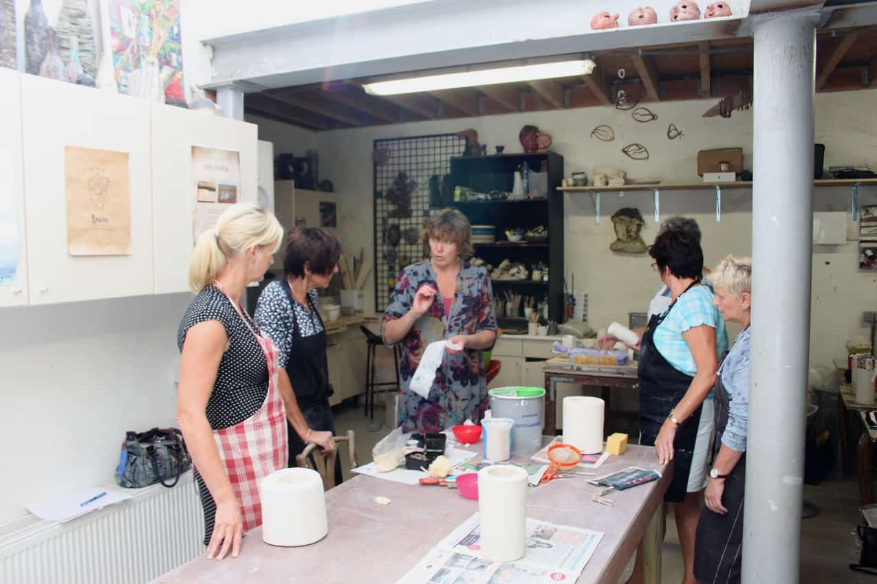 Travelers learning about ceramics in Belgium. Photo courtesy of VAWAA.