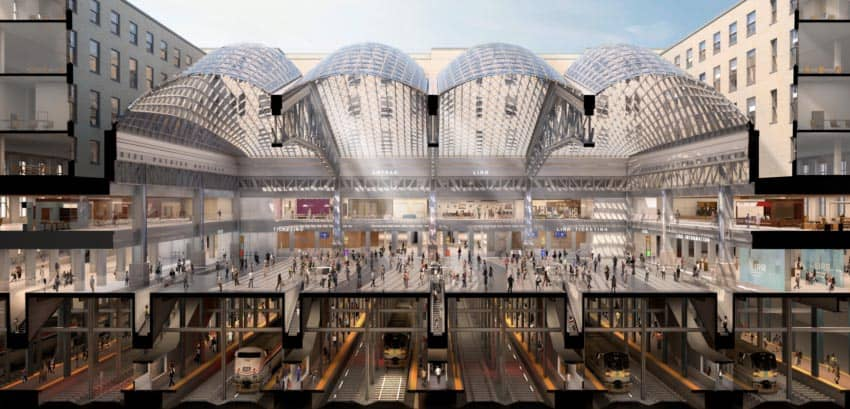 The cutaway view of the new Moynihan Train Hall shows how the tracks are still the same, they just end up under this second building south of the current Penn Station.