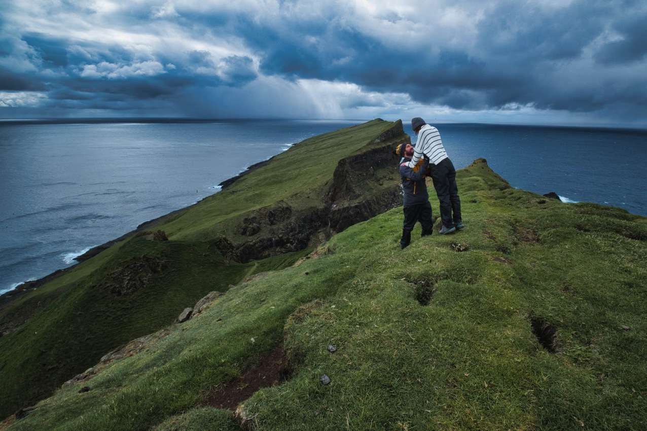 Nomads RTW trekking somewhere in the Faroes.