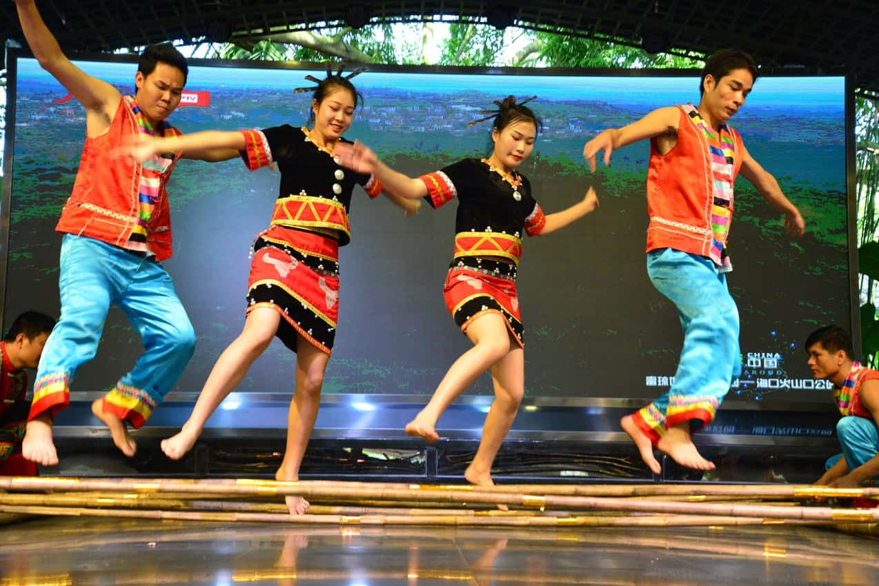 Li people, the earliest inhabitants of Hainan, perform a traditional bamboo dance that encourages friendship.
