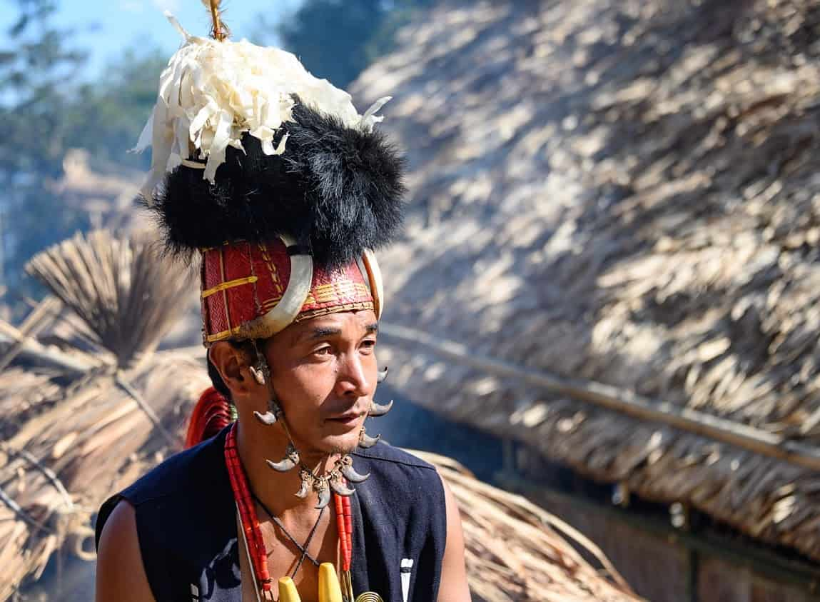 A Sangtam tribal warrior takes a break from the dancing. Each tribe has their own distinct dress.