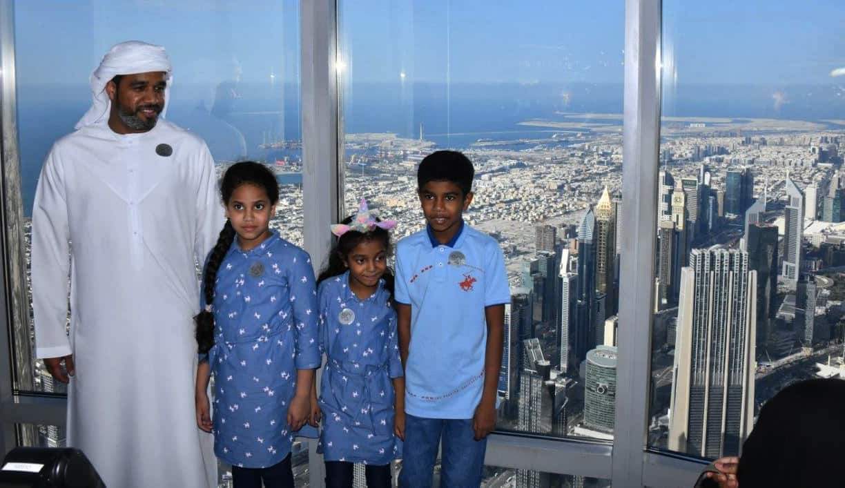 A Dubai family enjoys the day out and the view in the Burj Khalifa