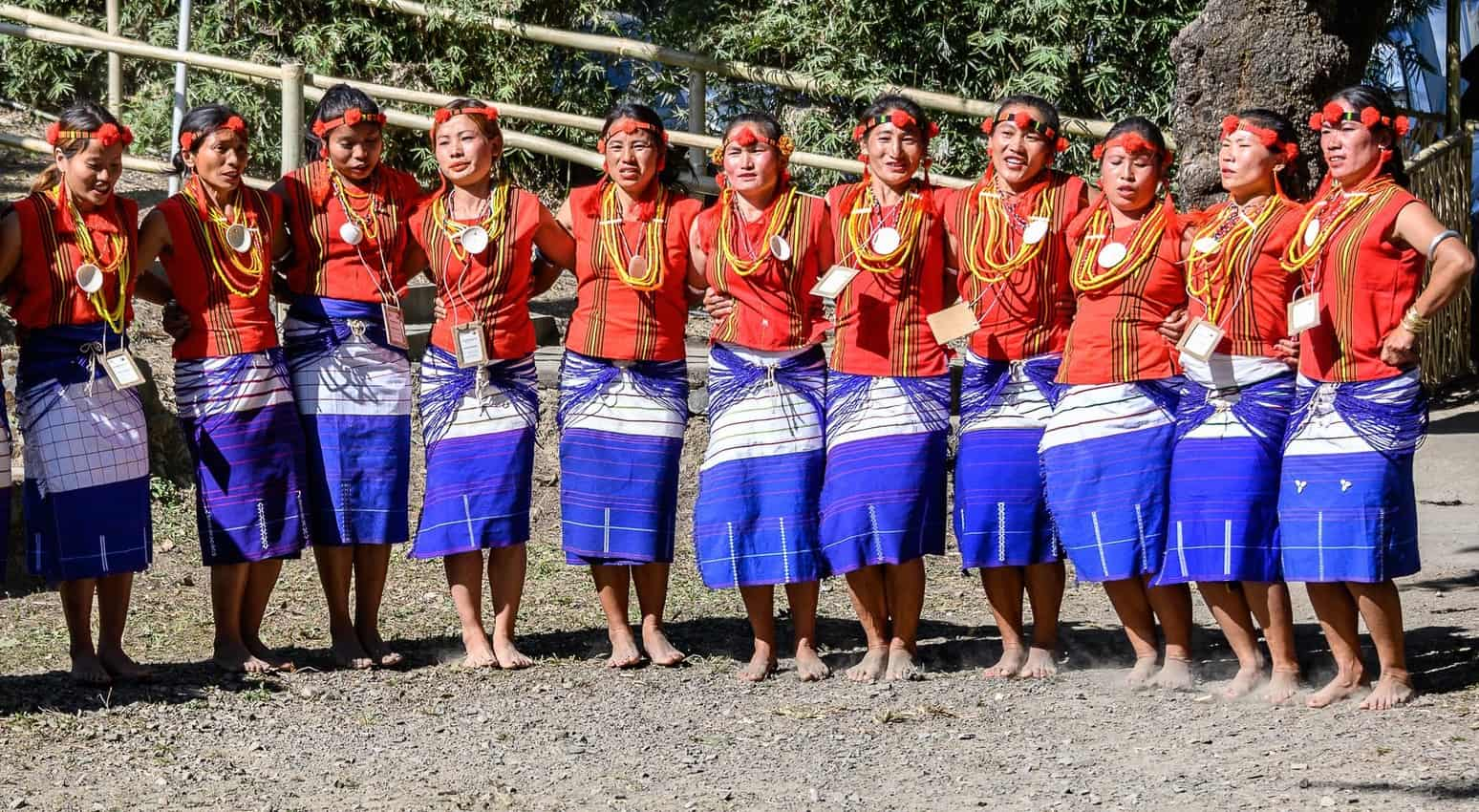 Tribal women dancing barefoot lock arms as they move in a counterclockwise circle during a demonstration at the Hornbill Festival in Nagaland, India. Donnie Sexton photos.