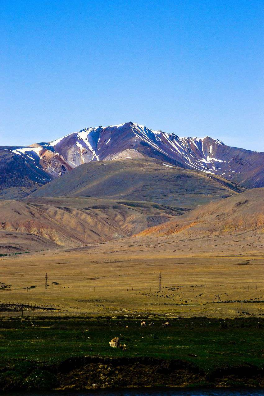Chui Steppe, Altai Republic. Intermountain basin, surrounded by ridges. Behind the ridges is the border with Mongolia. Height above sea level is 1700-1800 m. Chui steppe is yellow red shades all year round, that is why this site was named