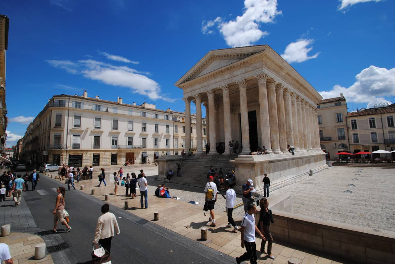 The Maison CarrÇe is a former forum and ancient surviving structure of Roman civilization in a busy square in Nimes.