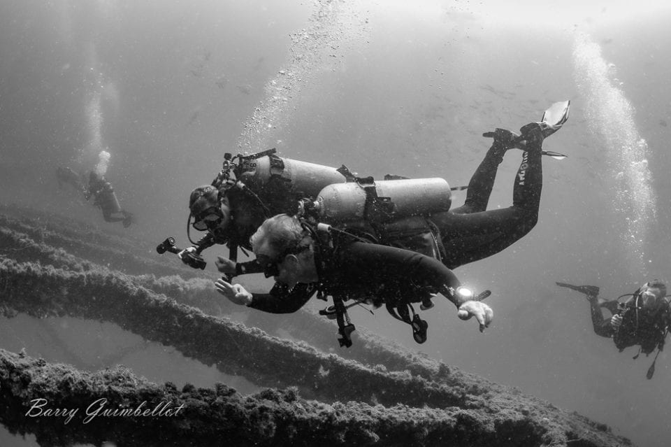 Ed and Jennifer diving in Panama City Beach, Florida. Photo by Barry Guimbellot.