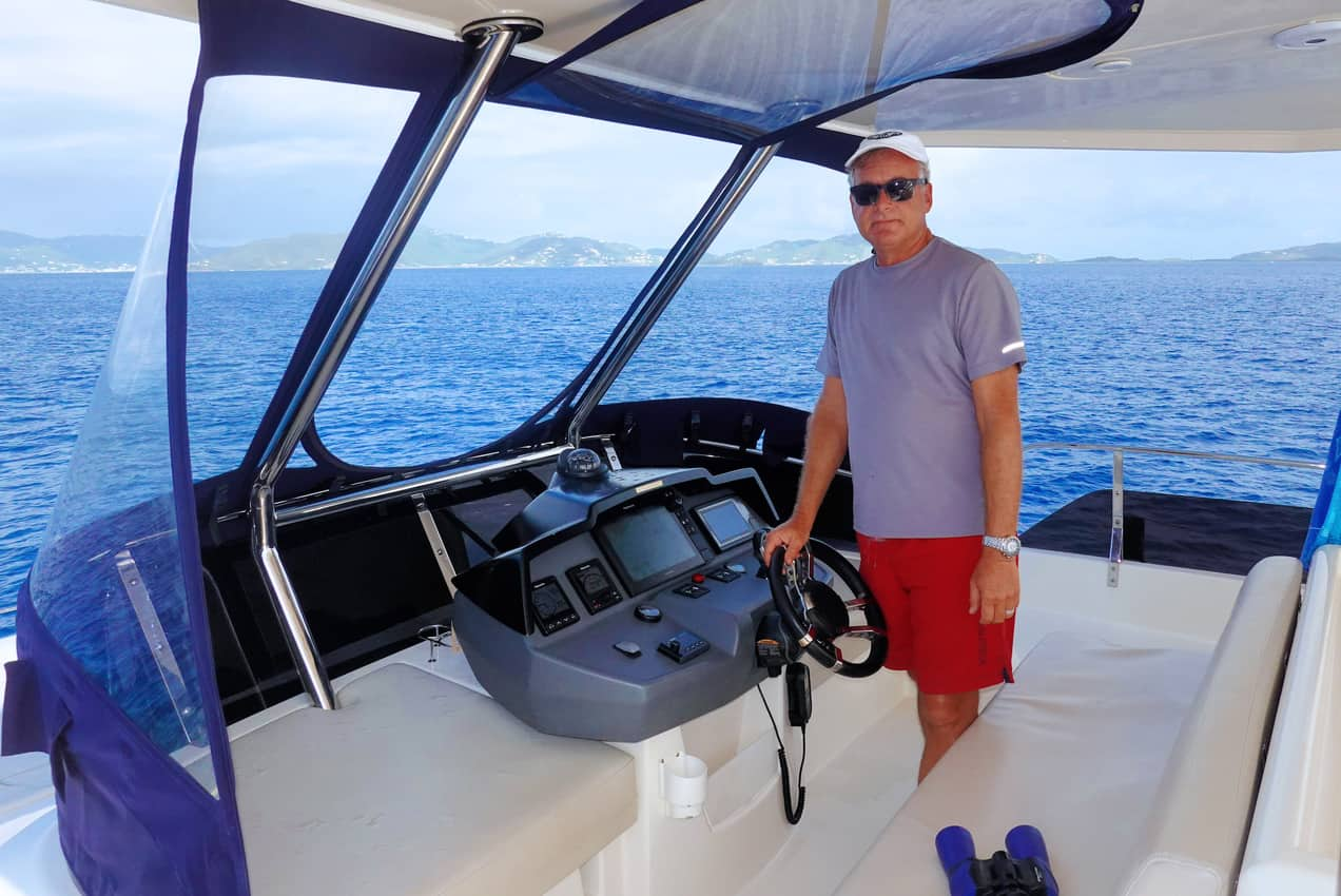 Captain Tab Hauser at the Helm in the British Virgin Islands.