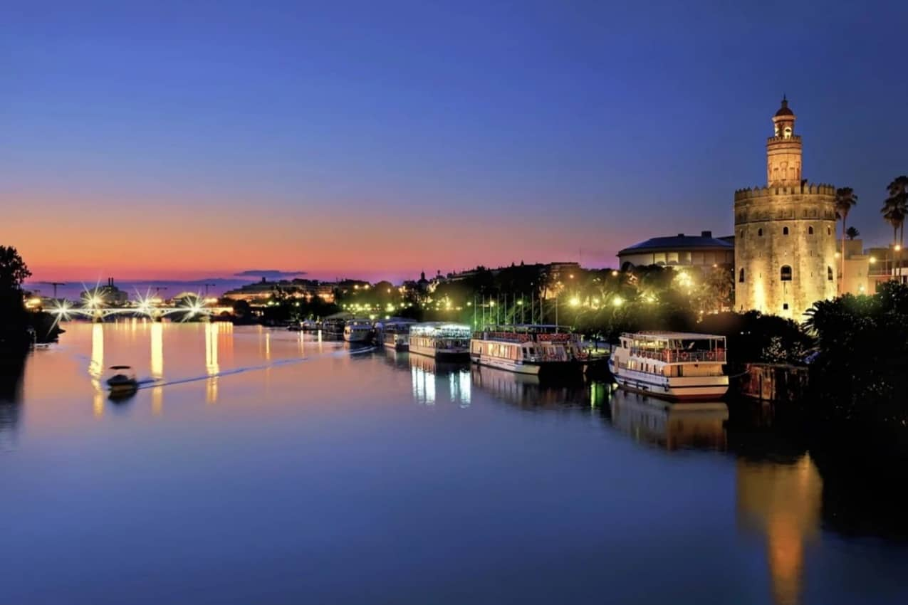The Golden Tower and Triana Bridge in Sevilla in its sumptuous nightglow