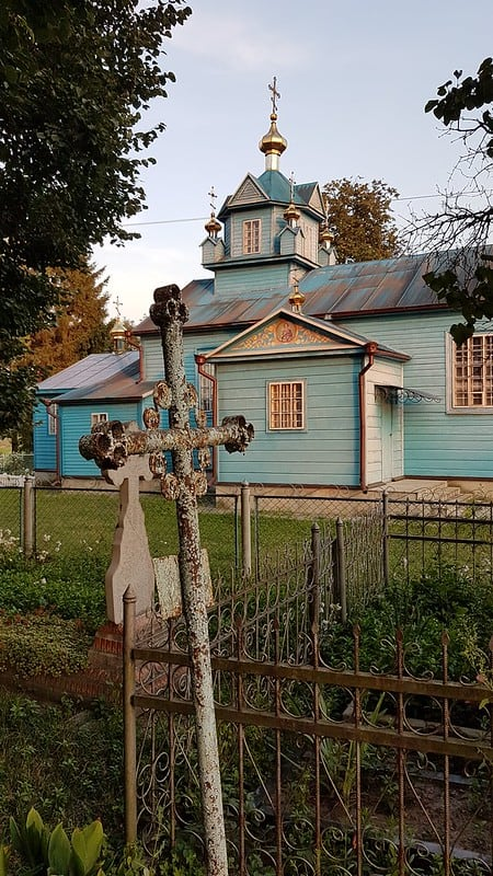 The beautiful village of Koryst, with a unique blue church and corresponding blue cemeter