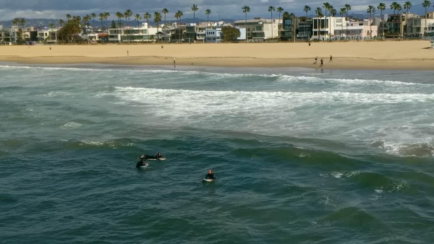 A few surfers on Venice Beach California
