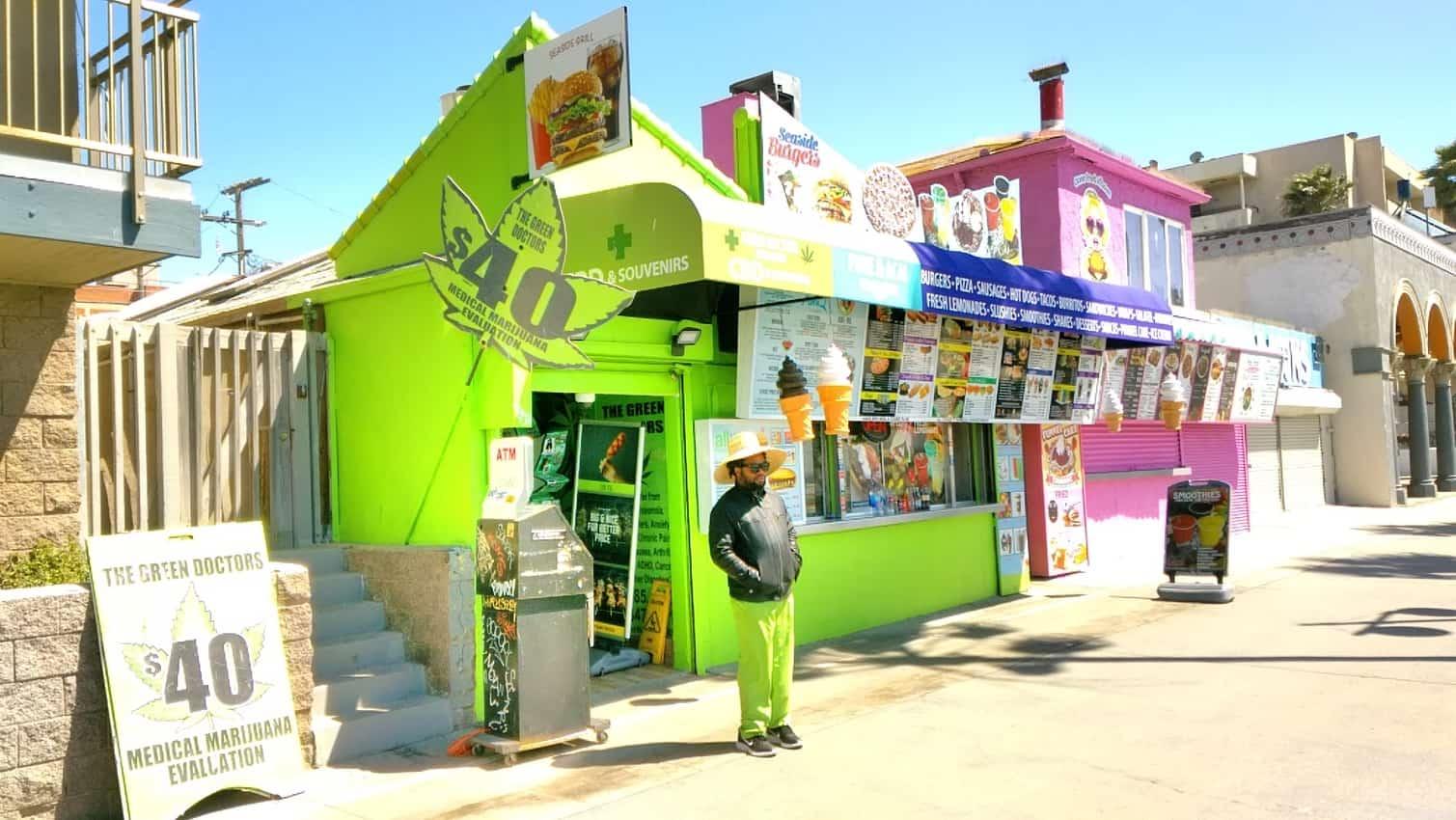 Open marijuana dispensary on the Venice Beach boardwalk; other shops are closed