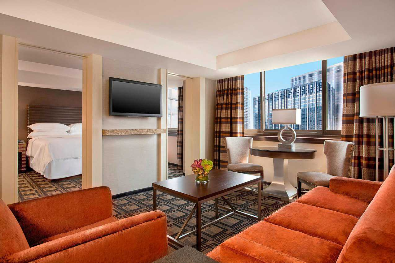 The New York Sheraton's Club Suites are about the size of a New York City apartment. Definitely room enough for two couples to share and have plenty of room to party!