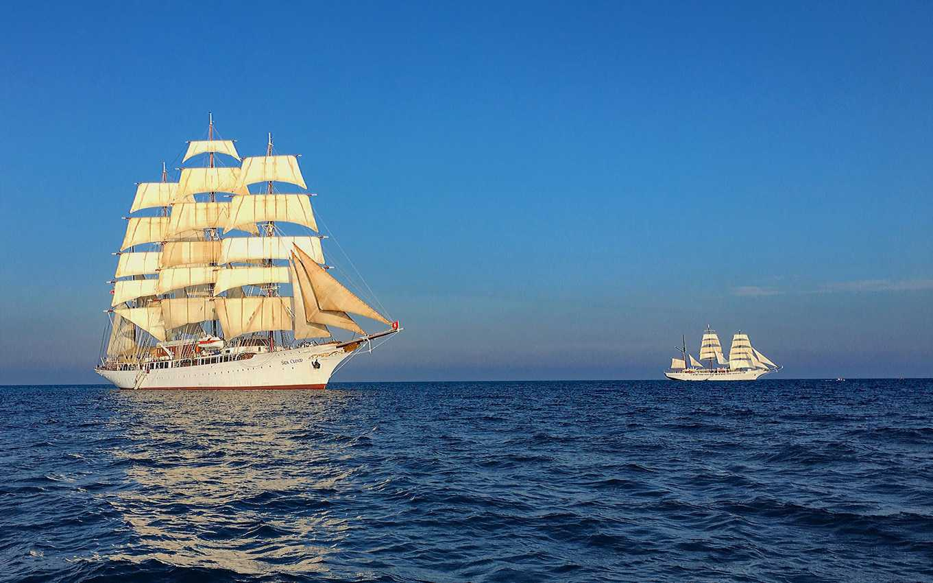 Sea Cloud, left, often sails with sister ship, Sea Cloud II, on fall cruises along the coast of Spain.