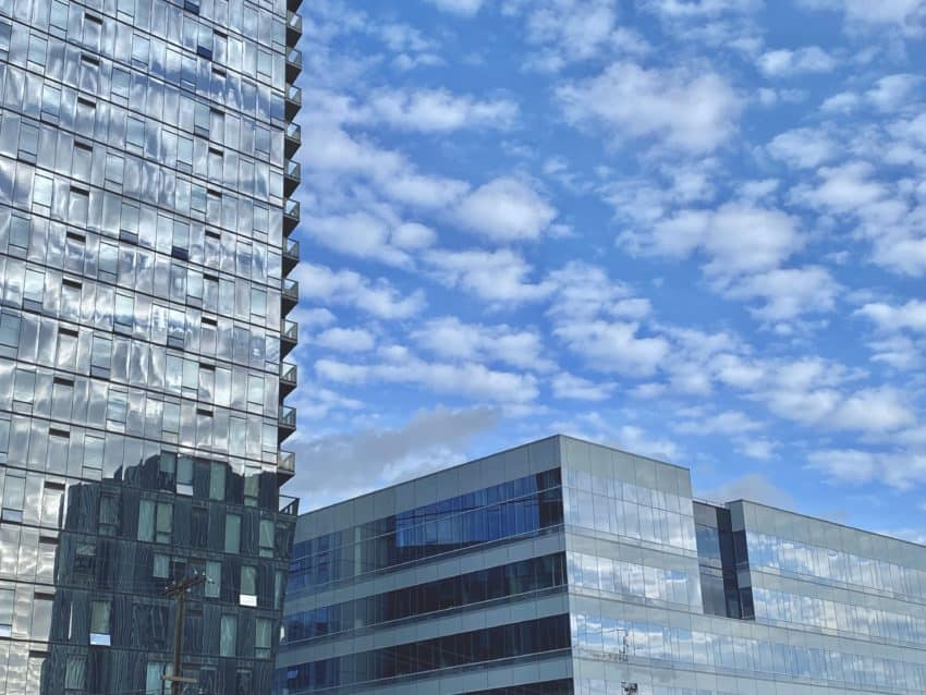 Stratocumulus clouds reflect amongst glass panes at the newly redeveloped Columbia Square, home to the CBS Television Network for almost seven decades.