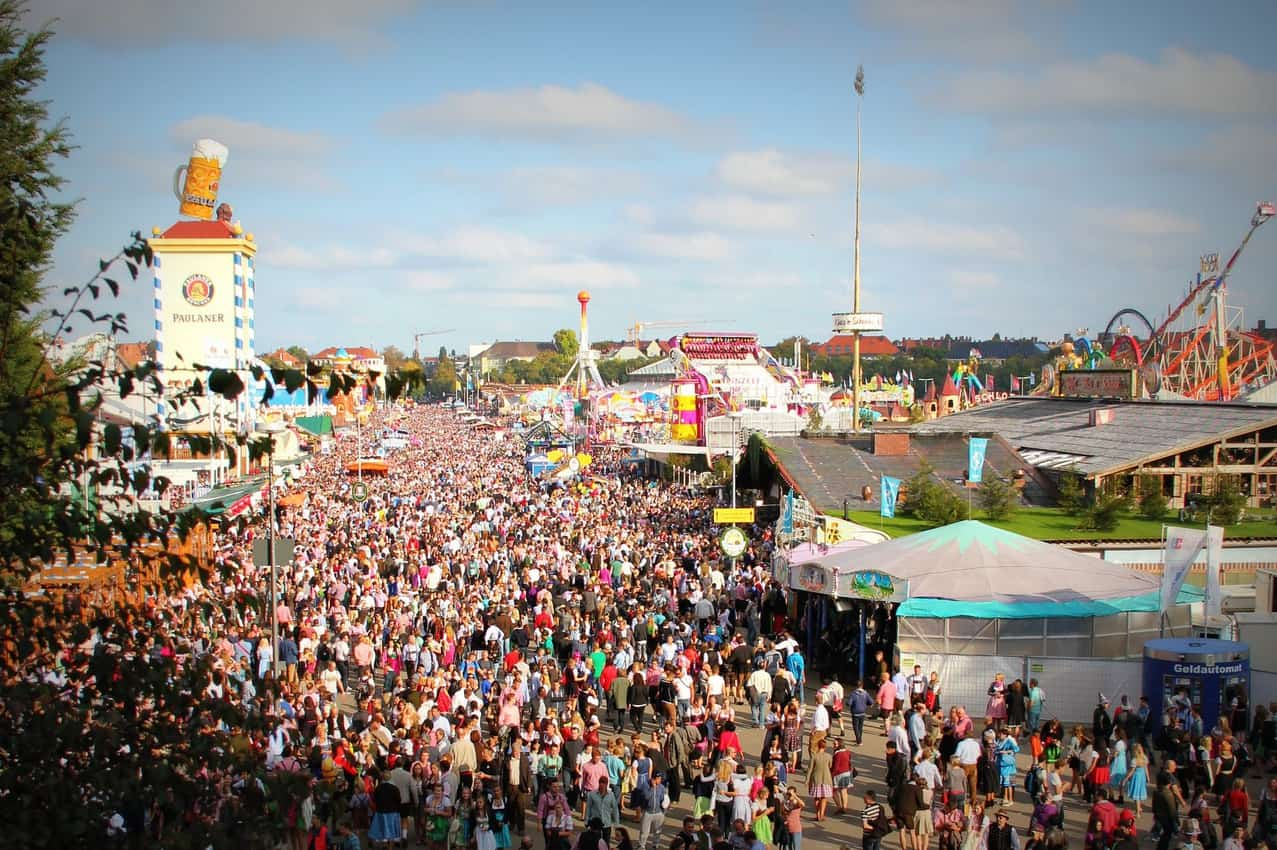 The giant, beer-drinking crowd at Munich's famous Oktoberfest. Don't carry too much cash.Pexels photo.