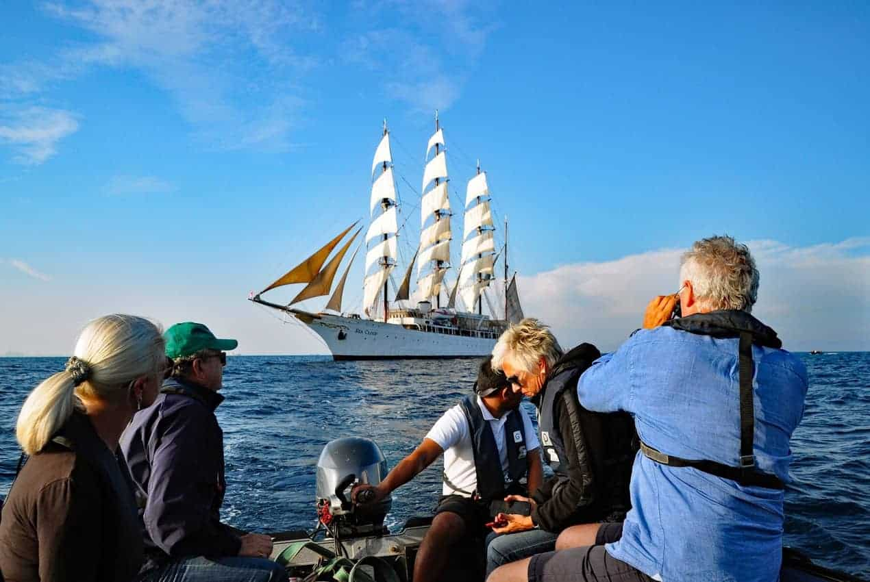 Zodiacs take passengers on a photo safari to shoot Sea Cloud with her sails up.