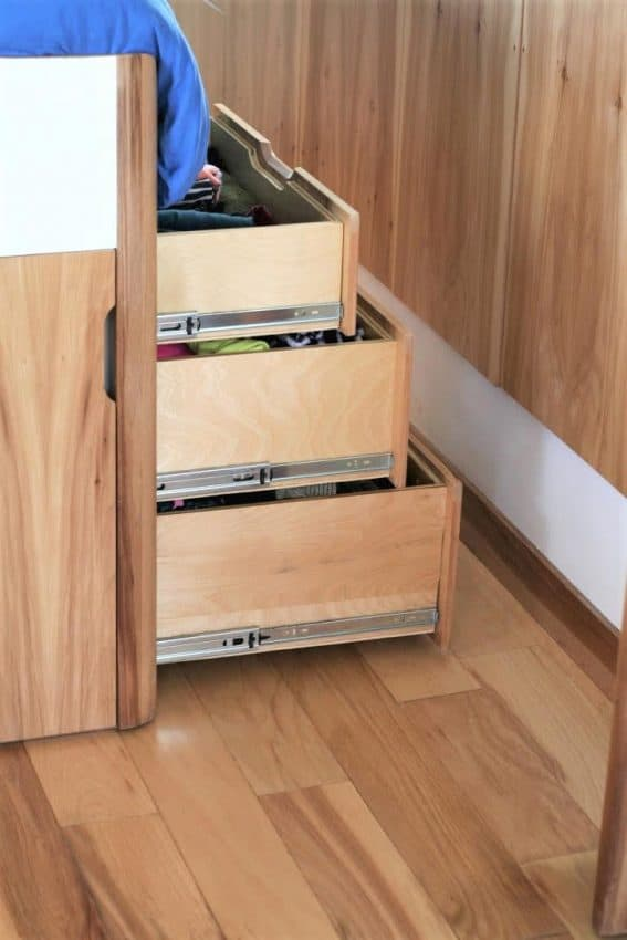 The raised bed provides under the bed storage in the Airstream.