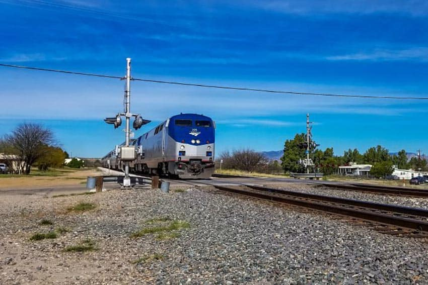 Amtrak train approaches a crossing