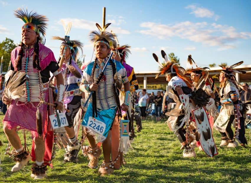Dance competitions during the powwows are divided by both age groups and by the style of dress contestants wear. These contestants are competing in the 'traditional' category.
