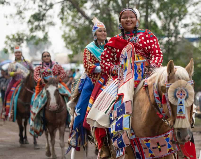 Unique to the Crow Fair is a spectacular parade featuring hundreds of Crow Indians, many on horseback, slowly making their way thru the powwow grounds.