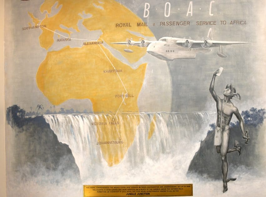 Victoria Hotel mural announcing weekly seaplane service from England