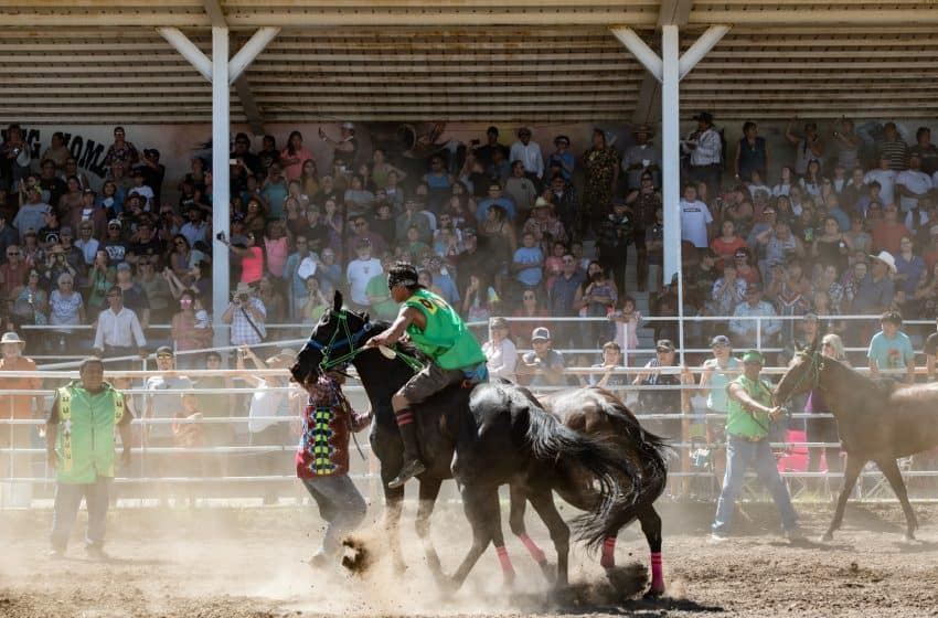 The wild and wooly Indian Relay teams consist of three horses, one rider, one mugger or catcher, and two holders.