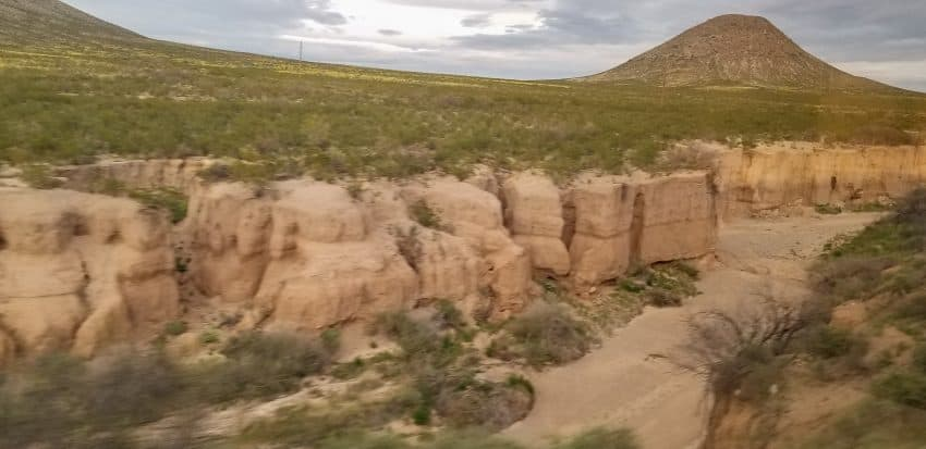 Rugged landscape of the south passing by the train window.