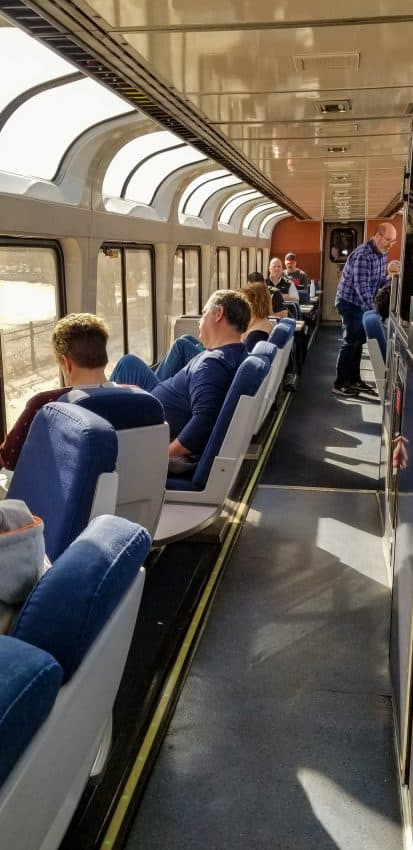 People gathered in the Observation Car on an Amtrak train
