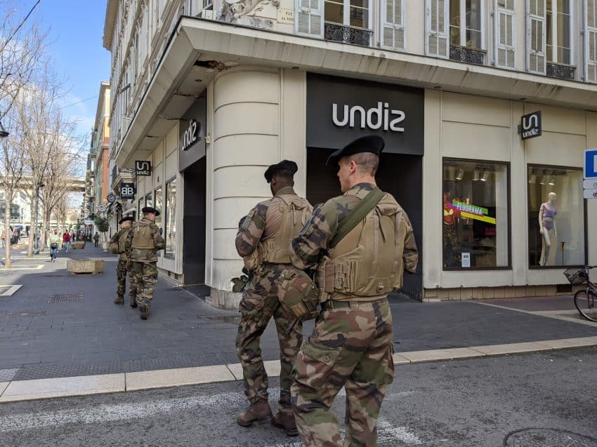 Soldiers on patrol looking for anyone who is outside of their homes without an official reason to travel in Nice, France.