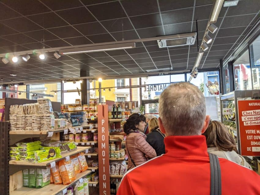 Lining up in the local grocery store--on a rare moment of freedom in Nice.