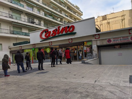 The lines start outside of the supermarket in Nice.