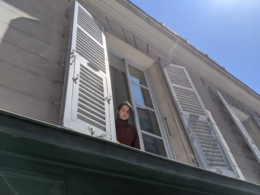 The author's daughter Erysse in their Nice, France apartment windows.