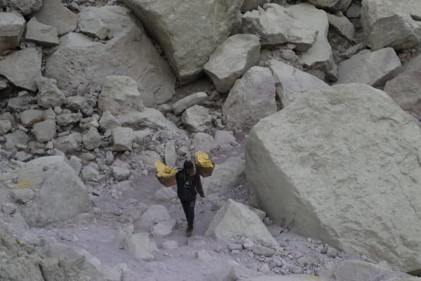 A miner carries sulphur out of the Ijen Crater in East Java, Indonesia. Caitlin Ashworth photos.
