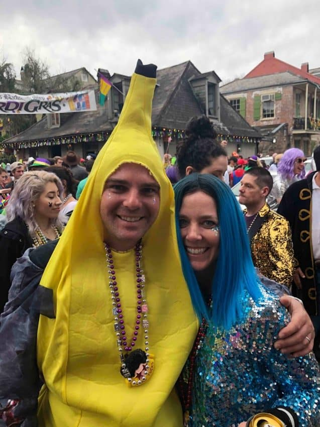 My husband Jim as a banana, and me, the blue-haired 80s rock star on Mardi Gras day