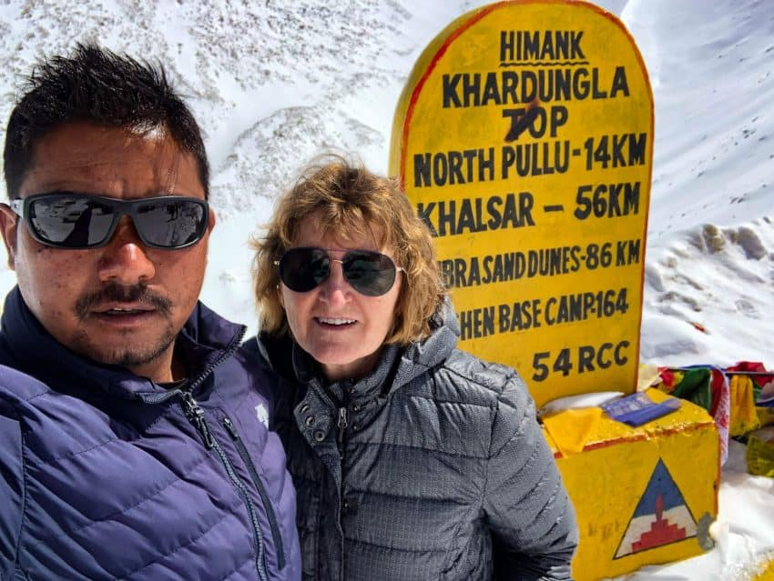 The author and her guide Tensin take the mandatory selfie, proof they made it safely to the top of Khardung La Pass, Ladakh, India.