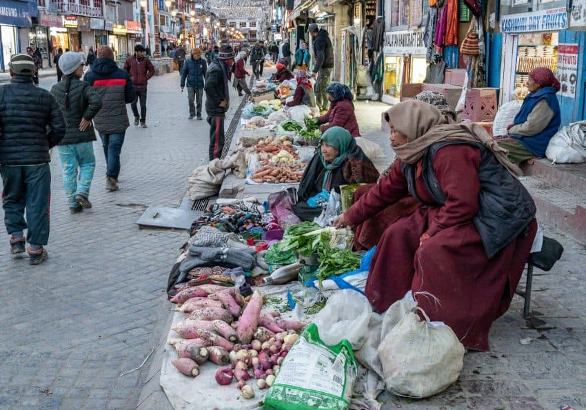 Vendors (mostly women) use the sidewalk in Leh Ladakh for selling vegetables and handmade goods.