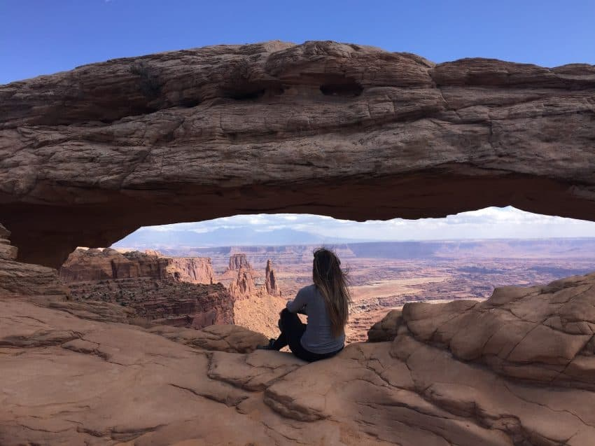 One of the beauty spots in Canyonlands National Monument is Mesa Arch, which is swamped with people at dawn when the sun shines under the arch, but far less crowded and easily accessible from a parking lot at other times.