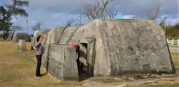 Viewing a Japanese bunker on Saipan. Japanese sheltered in ones like this during battle of Saipan.