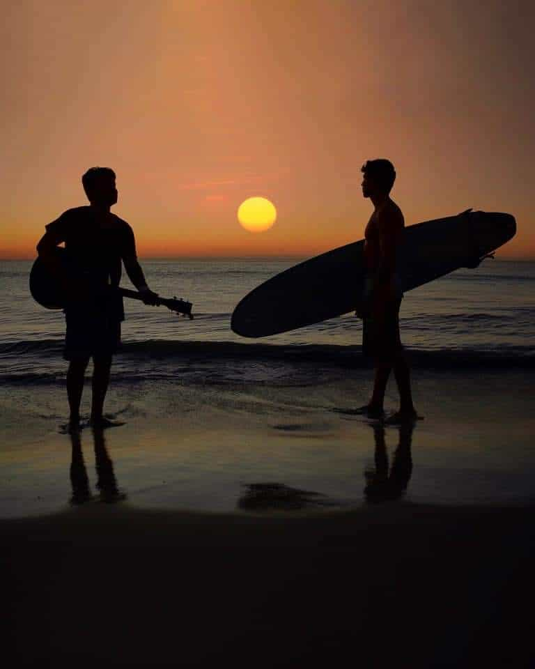 A guitarist and a surfer on the beach in Jericoacoara, Brazil. Johnny Motley photos.