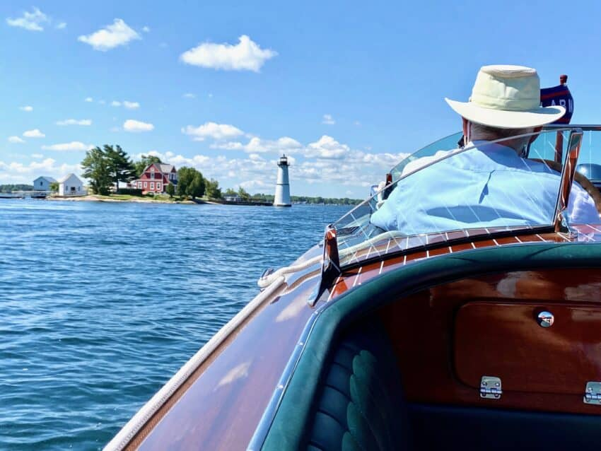 A wooden boat is the best and funnest way to explore the 1800 islands that make up the Thousand Islands, between NY and Canada on an Empire State Road Trip..