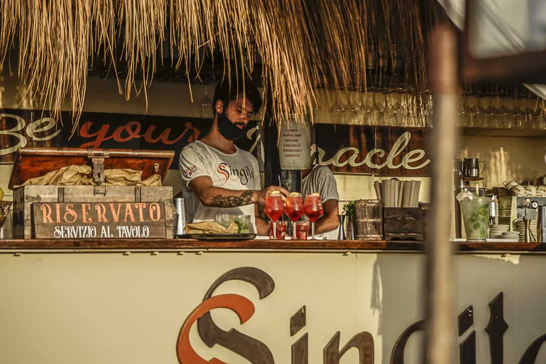 A bartender mixing drinks at Singita. Photo by Marina Pascucci