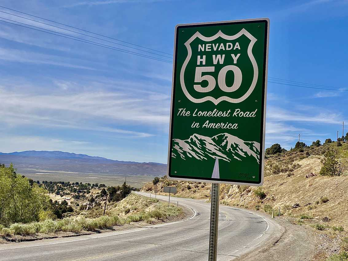 Spanning hundreds of empty miles, U.S. Highway 50, known as the Loneliest Road in America, stitches together a mere handful of tiny towns along its mirage-etched asphalt ribbon.
